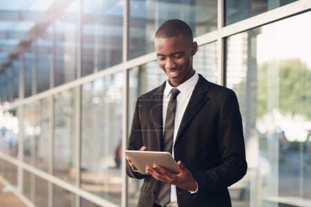 African man in suit using digtal tablet