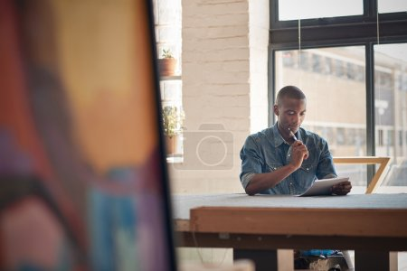 entrepreneur sitting at table with paper and pen