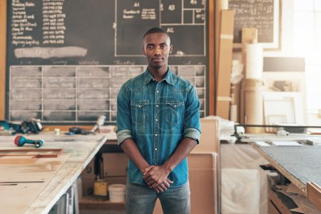business owner standing in woodwork studio