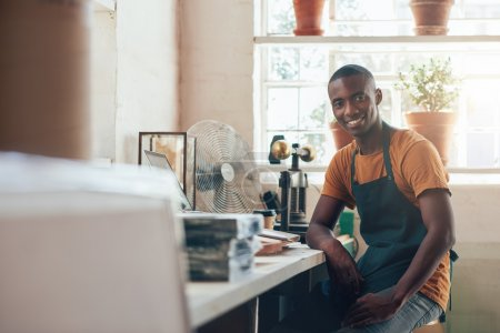 craftsman smiling in workshop studio