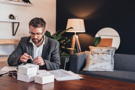 entrepreneur preparing packages for delivery to customers