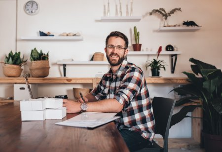 entrepreneur sitting at table using laptop
