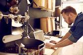 man in work space using laptop