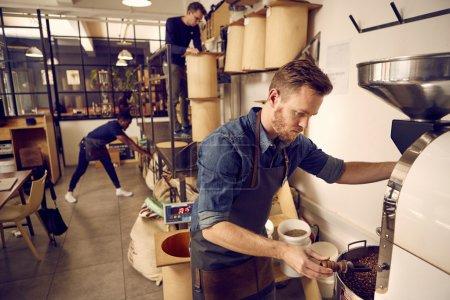 Men working in modern coffee roastery