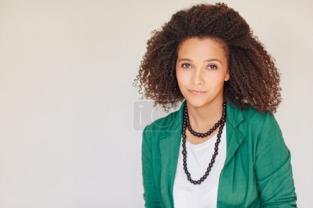 Photo for Portrait of a mixed race businesswoman smiling at the camera with a beautiful curly afro hairstyle - Royalty Free Image
