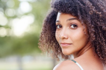 Portrait of a beautiful young mixed race woman in ...