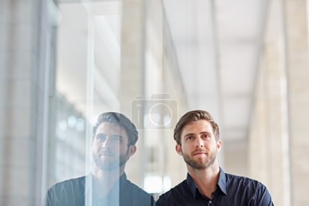 businessman looking positively at camera