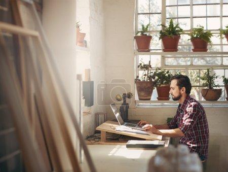 Designer working in creative office space