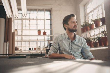 business owner looking away in studio