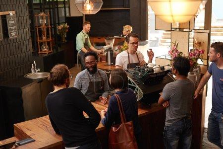 baristas working behind counter