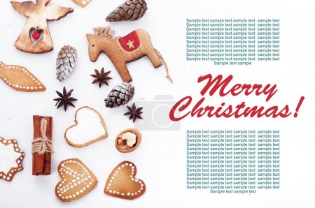 New Year's and Christmas background. Christmas ornaments, pine cones, cinnamon and ginger biscuits with meringue on a white background. Place for writing the text or congratulations