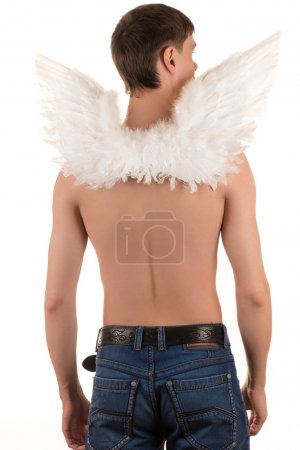 topless man with white angel wings on his back and arms down looking to the side
