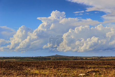 Country landscape: Alta Murgia National Park.In the background Castel del Monte.Apulia,ITALY.