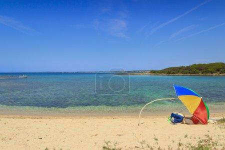 Summertime beach.Ionian coast of Salento:Porto Cesareo:Nature Reserve Isola Grande (Lecce).- ITALY (Apulia)