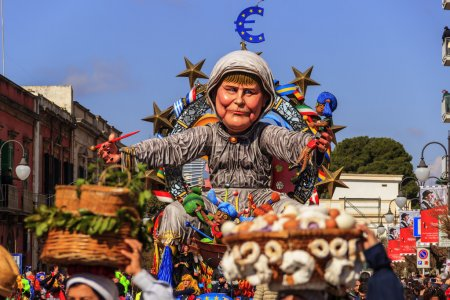Putignano,Apulia,Italy - February 15, 2015: carnival floats, giant paper mache. European politician: Angela Merkel. Carnival Putignano: floats. Angela Merkel torture the European Community.