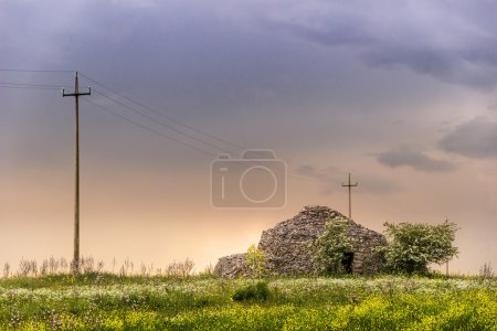 Springtime.Apulia countryside: typical rural landscape with trulli.Italy