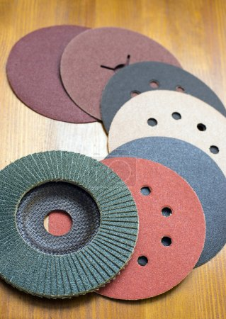Abrasive materials - sheets of sandpaper and disks close-up