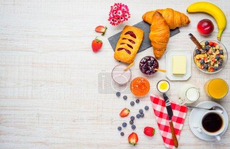 Breakfast table with coffee, muesli and fresh frui...