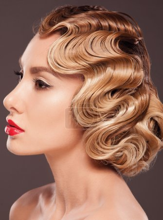 Photo for Beautiful blonde woman with evening make-up and salon hairdo in retro style - Royalty Free Image