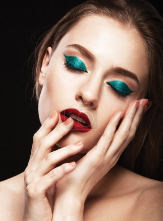 Beautiful model with make up and manicure