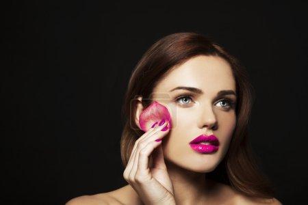 woman with rose petal sponge