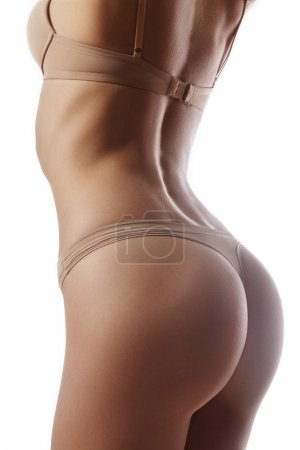Beautiful female slim body. Beauty part of female body. Woman's shape with clean skin.Diet and fitness.Healthy lifestyle. Ideal waist, perfect buttocks and legs, sexy back.