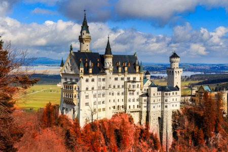 Photo for Neuschwanstein Castle with red foliage, Schwangau, Germany - Royalty Free Image
