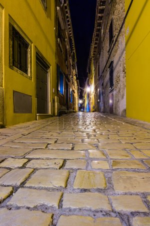 Narrow street in night of old town