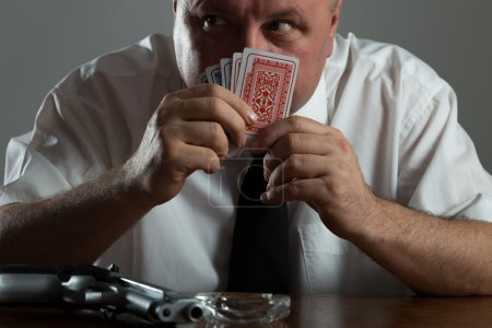 portrait of businessman smoking and play poker