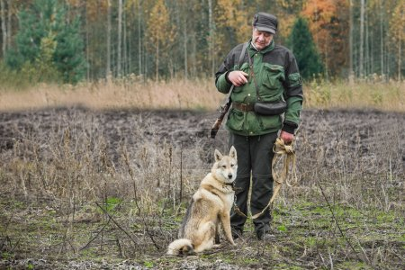 Male hunter with dog