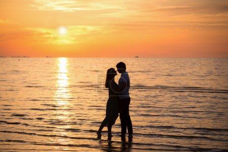 Loving couple on the coast