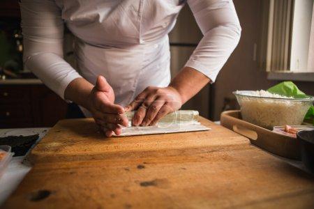 Chef making rolls