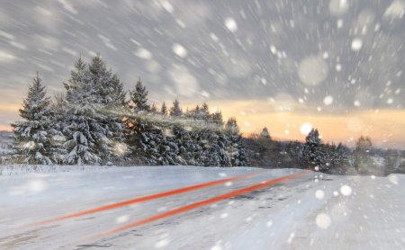 Winter road with snow showers