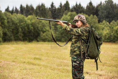 Woman hunter in forest