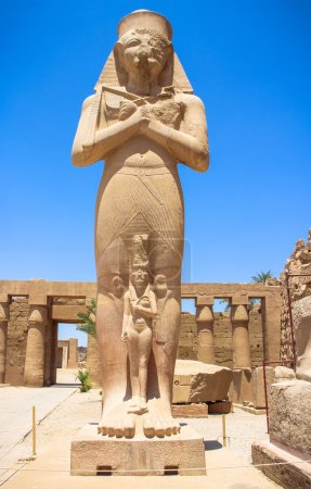 Statue of Ramses II with his daughter Merit-Amon in the temple of Amun-RA (the temple of Karnak in Luxor)
