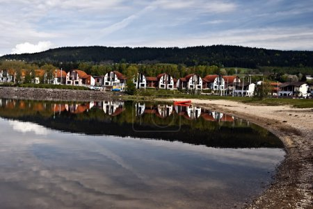 Lipno resort with sandy beach, Lipno dam and hill
