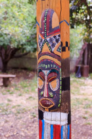 North American totem mask on the totem pole