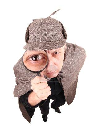 Photo pour Ce détective enquête sur l'affaire avec loupe. - image libre de droit