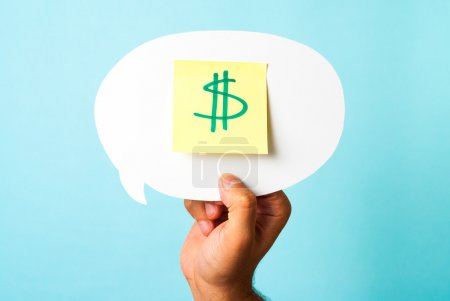 Finding the right investment opportunity. Green dollar money sign symbol on stick-note over speech bubble and blue background.