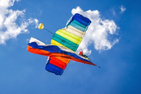 Parachutist fly with colorful canopy and russian flag
