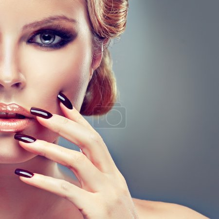 Model with fashion make-up and manicure