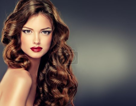 Photo for Beautiful woman with healthy long curly hair - Royalty Free Image