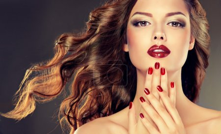 Photo for Beautiful female model with fashion make-up and perfect red manicure - Royalty Free Image
