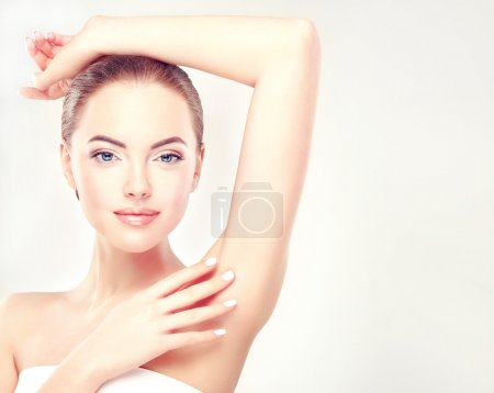 Girl showing clean armpit