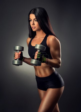 fitness woman lifting dumbbells.