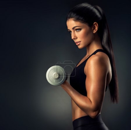 fitness woman lifting dumbbell
