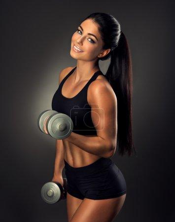 fitness woman lifting dumbbells.