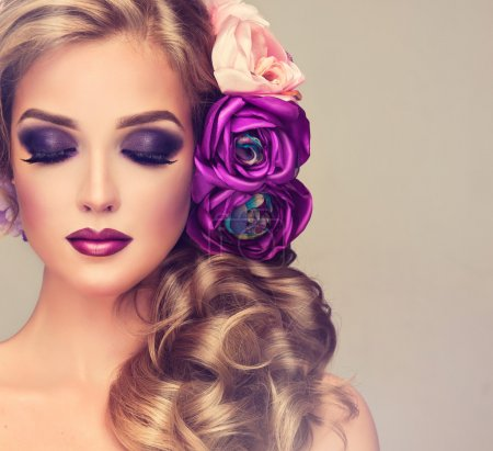 Photo for Beautiful  Woman with curly hair and flowers and perfect make up - Royalty Free Image