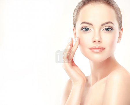 Beautiful young Woman with Clean, Fresh Skin.Cosme...