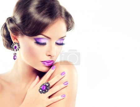 Fashionable model with  violet makeup